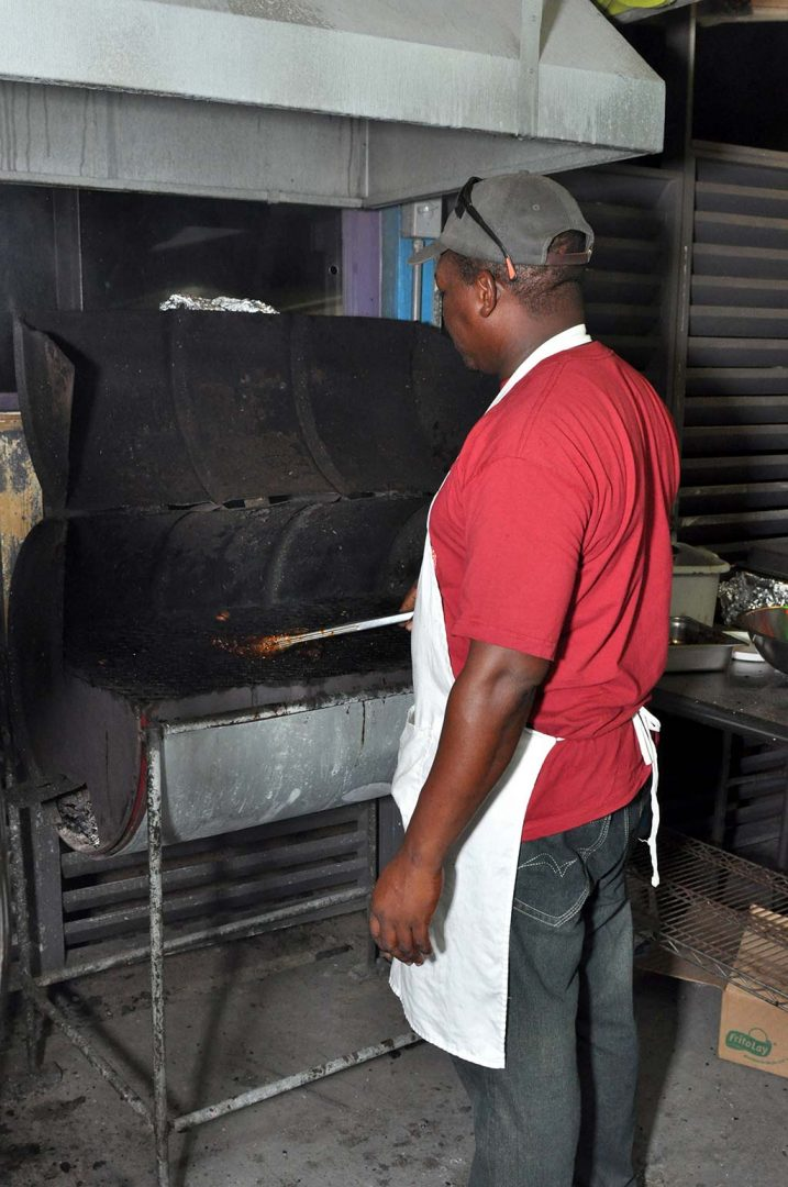 chef peter preparing is flaming grill at trellis bay market