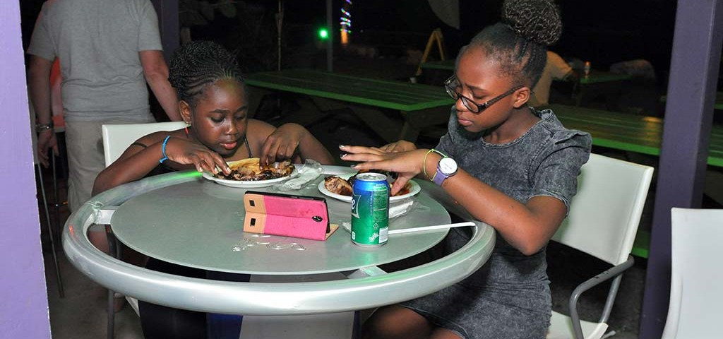 kids enjoying their bbq meal at trellis bay market british virgin islands