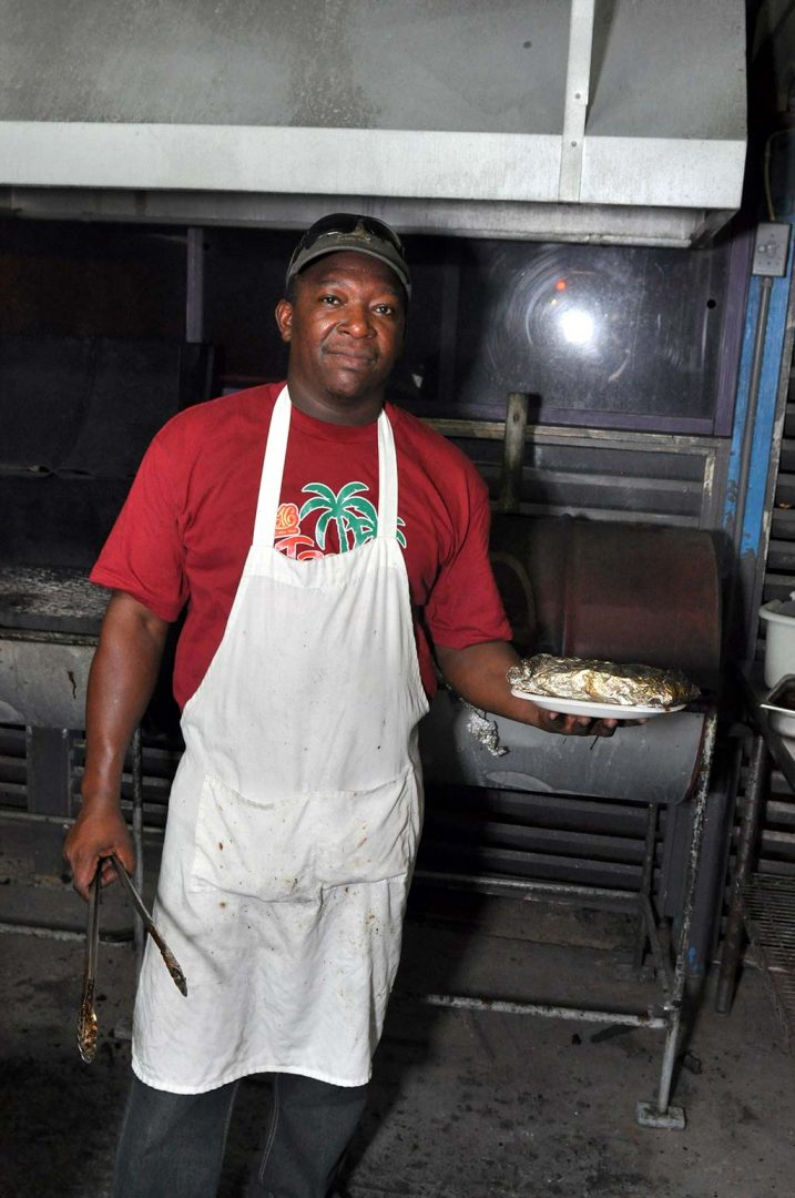 trellis bay market grill master serving grilled fish