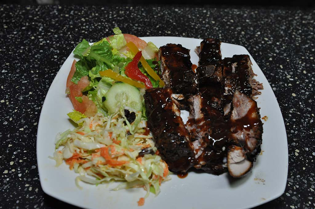 mouth watering bbq ribs, coleslaw and green salad at trellis bay market