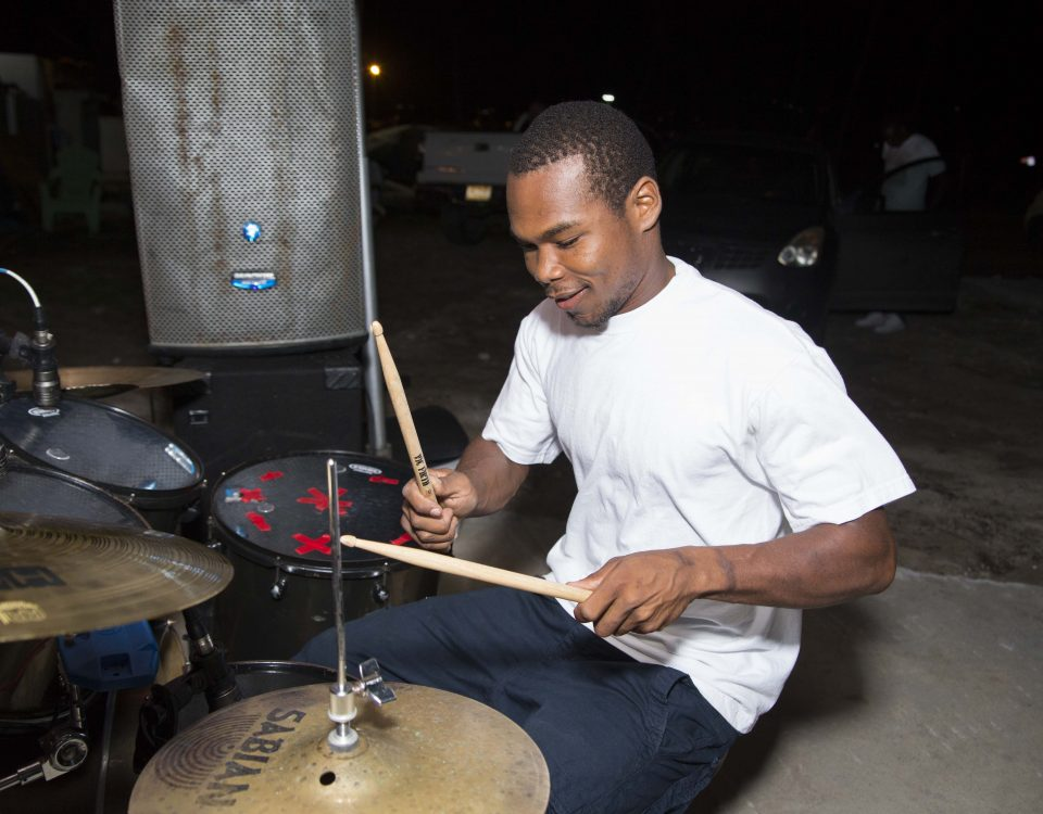drummer performing arm band singing away outdoor chill at trellis bay market