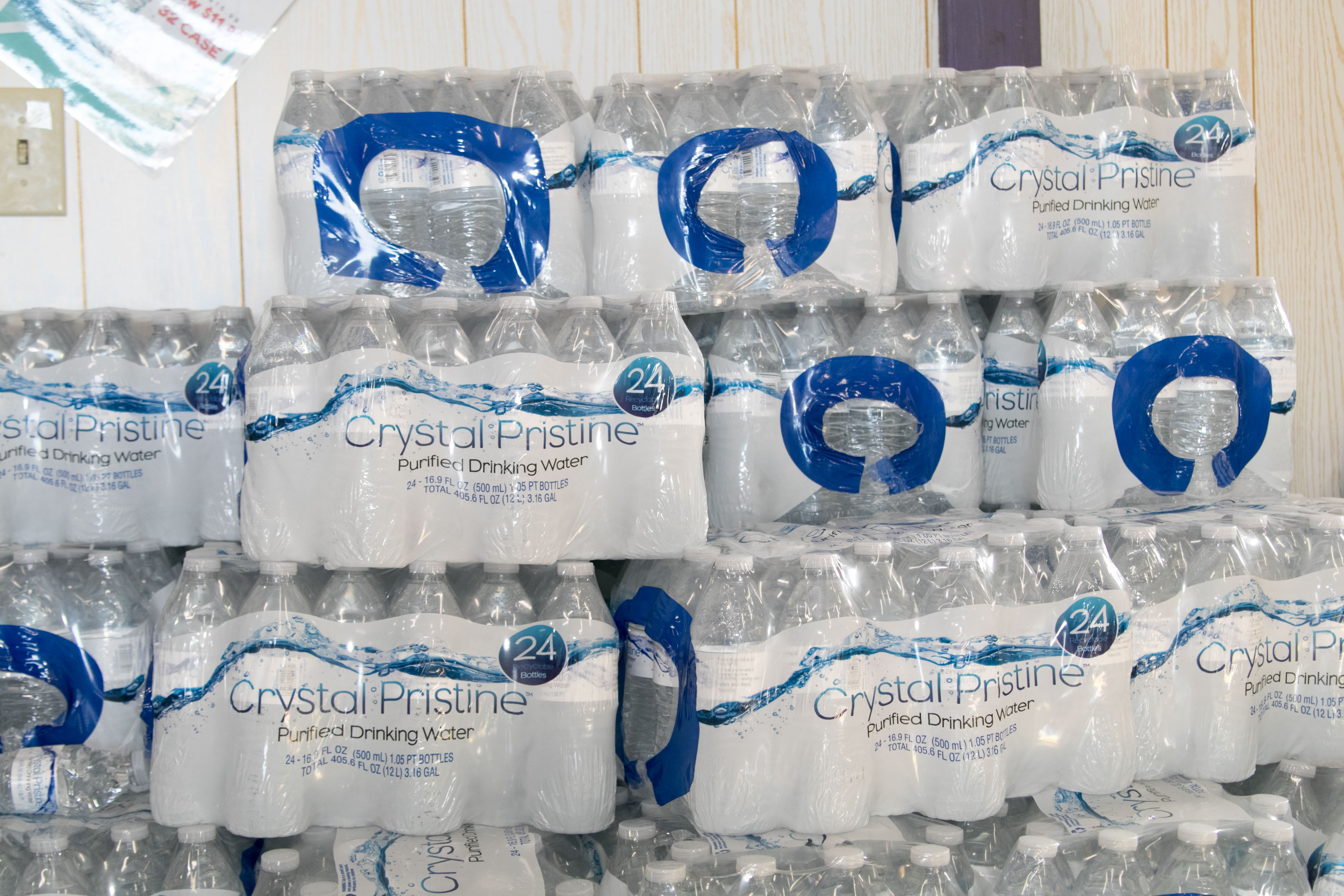 cases of water available at trellis bay market